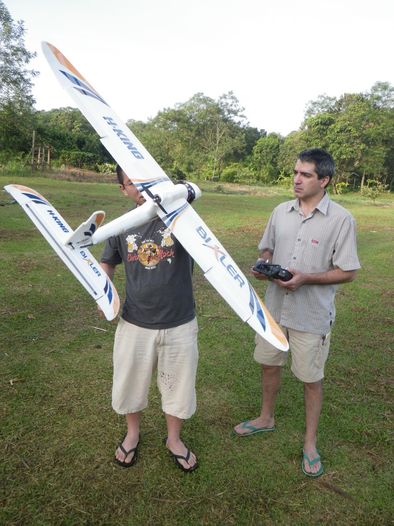 Lian Pin Koh and Serge Wich prepare their drone for flight.  photo for the OC archives.